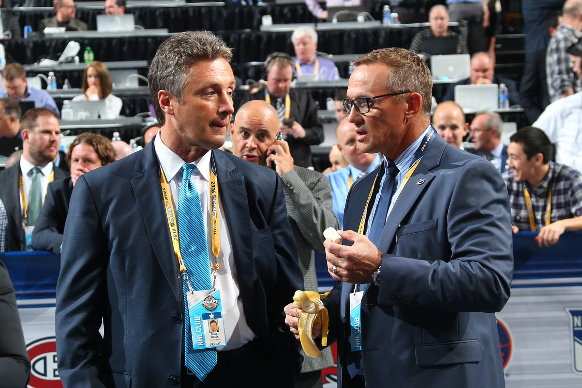 BUFFALO, NY - JUNE 24: San Jose Sharks General Manager Doug Wilson talks to Tampa Bay Lightning General Manager Steve Yzerman during round one of the 2016 NHL Draft on June 24, 2016 in Buffalo, New York.