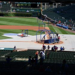 1:13 p.m. Protective cover over the infield, during batting practice -