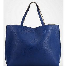 """Rain, sleet, shine, or snow, the <a href=""""http://www.urbanoutfitters.com/urban/catalog/productdetail.jsp?id=27953686&parentid=W_ACC_BAGS"""">Reversible Vegan Leather Oversized Tote Bag</a> ($59) from Urban Outfitters is a pack rat's dream come true."""