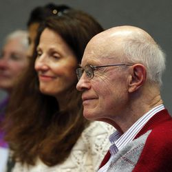 John Bennion, front, listens as the Utah Citizens' Counsel announces its 2014 Assessment of Utah's Policy Progress in Salt Lake City, Wednesday, Dec. 10, 2014. Behind him is Elizabeth Bennion.