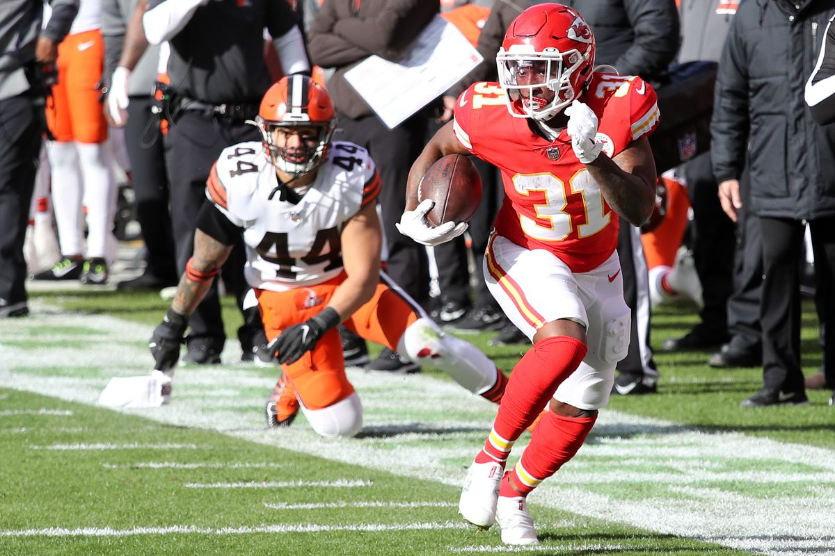 Running back Darrel Williams #31 of the Kansas City Chiefs carries the football over outside linebacker Sione Takitaki #44 of the Cleveland Browns during the first quarter of the AFC Divisional Playoff game at Arrowhead Stadium on January 17, 2021 in Kansas City, Missouri.