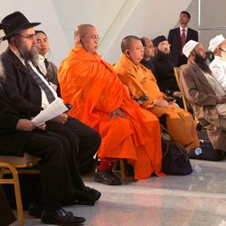 Representatives of Judaism, left, Buddhism, center, and Islam sit listening during the II Congress of Leaders of World and Traditional Religions in Astana, Kazakhstan, Tuesday, Sept. 12, 2006. Religious leaders gathering in Kazakhstan for a two-day forum opening Tuesday are scheduled to discuss tolerance, even as concerns mount over the increasingly hostile treatment of religious minorities in the country.