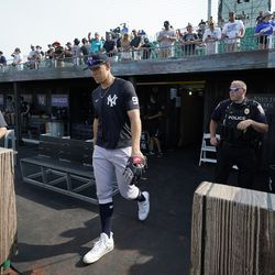 New York Yankees right fielder Aaron Judge walks to the field for warm ups before a baseball game against the Chicago White Sox, Thursday, Aug. 12, 2021 in Dyersville, Iowa. The Yankees and White Sox are playing at a temporary stadium in the middle of a cornfield at the Field of Dreams movie site, the first Major League Baseball game held in Iowa.