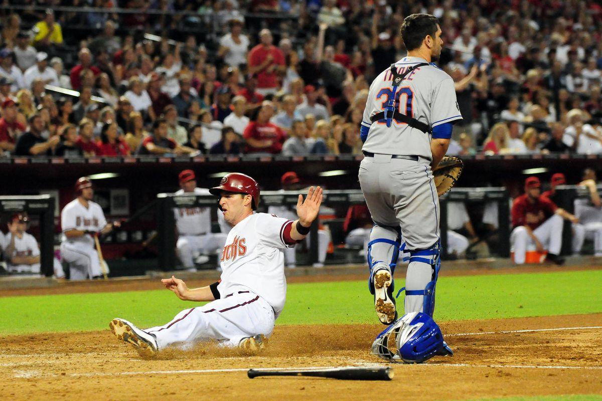 Jul. 27, 2012; Phoenix, AZ, USA; Arizona Diamondbacks base runner Stephen Drew (6) slides into home in the second inning against New York Mets at Chase Field. Mandatory Credit: Jennifer Hilderbrand-US PRESSWIRE