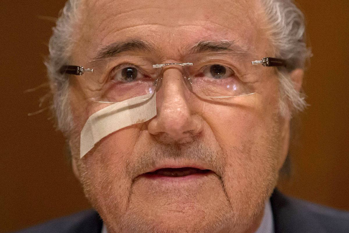 Sepp Blatter, who is stepping down in February, reacts to news that he's been banned.