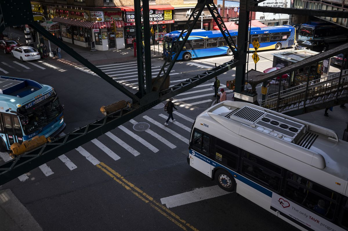 Buses at the intersection beneath the 61st Street-Woodside station in Queens on Friday, May. 7, 2021.