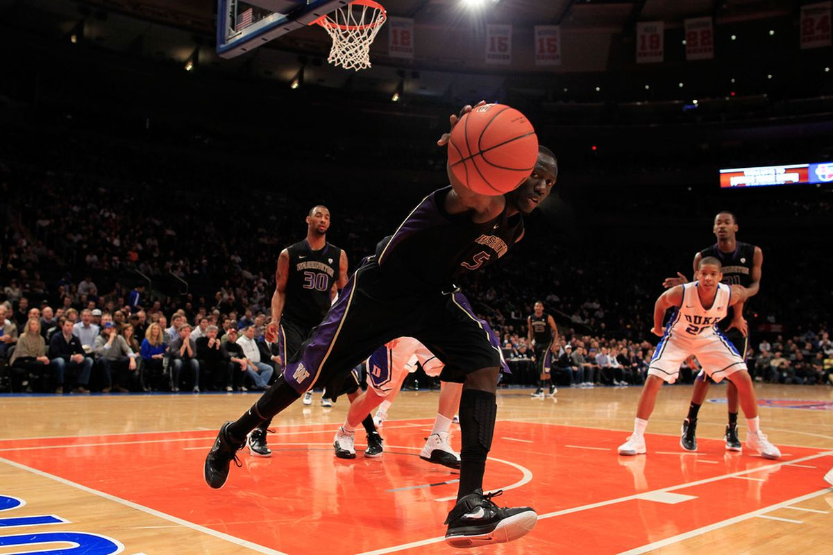 NEW YORK, NY - DECEMBER 10: Aziz N'Diaye #5 of the Washington Huskies rebounds the ball against the Duke Blue Devils at Madison Square Garden on December 10, 2011 in New York City.  (Photo by Chris Trotman/Getty Images)