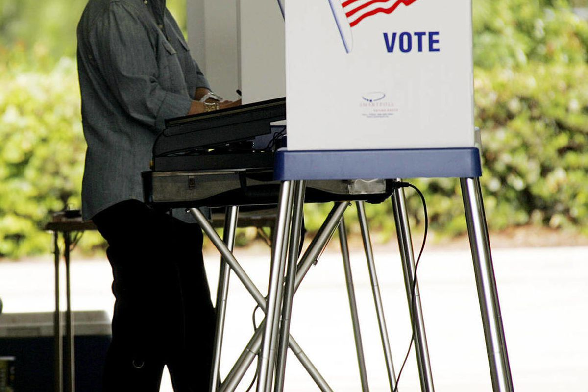 In this Nov. 4, 2008 file photo, a woman votes at a fire station in Jupiter, Fla. on election day. Republicans on Thursday, Sept. 27, 2012 fired a vendor suspected of submitting 106 questionable new voter registrations in Florida's Palm Beach County, grou