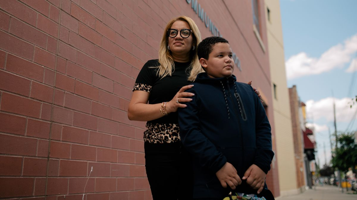 Milagros Reyes stands outside of the red-brick facade of P.S. 89 with her son, fifth grader José, on a beautiful June afternoon.