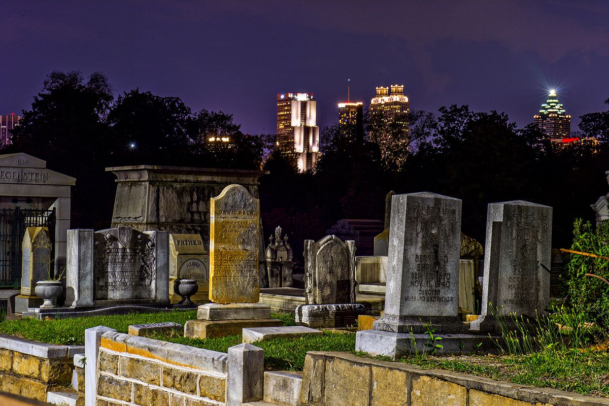 A night photo of creepy Oakland Cemetery in Atlanta.