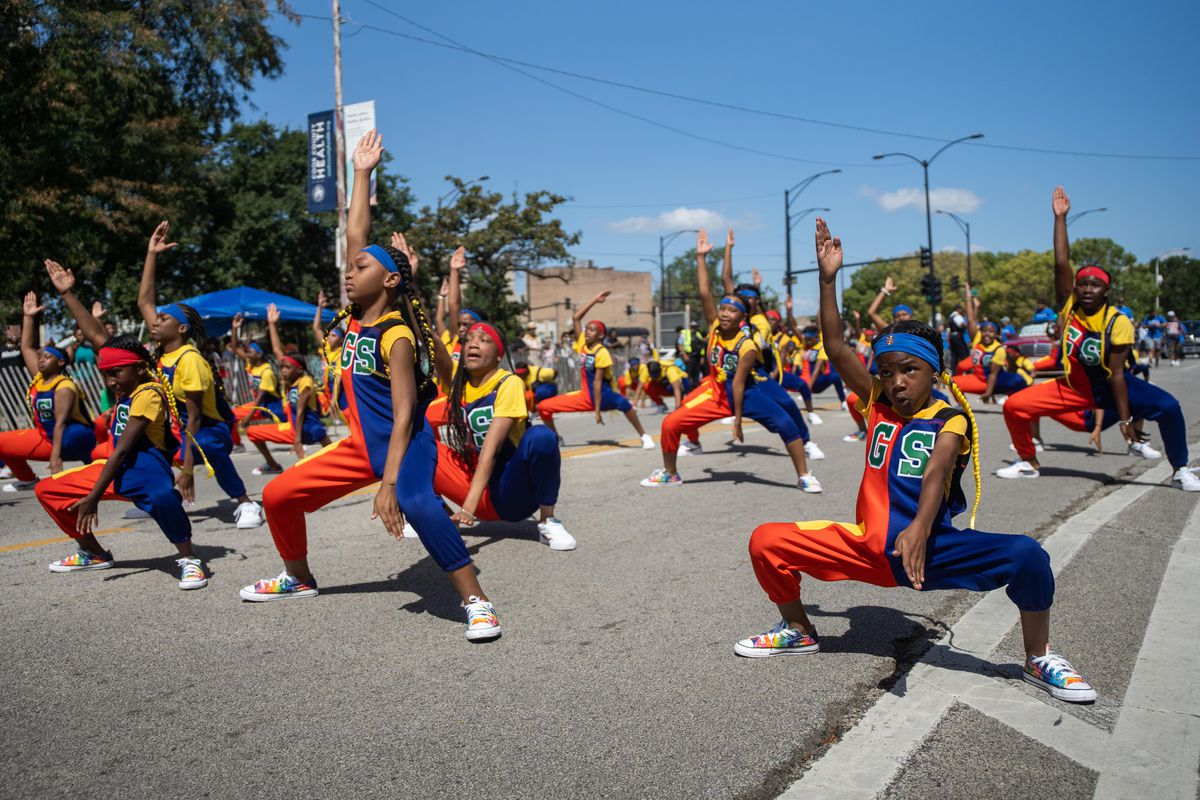 Geek Squad performs during the Bud Billiken Parade in the Bronzeville neighborhood, Saturday, Aug. 14, 2021. The parade, which was cancelled last year due to the COVID-19 pandemic, is now on its 92nd year.