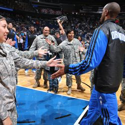 """Military personnel in the """"high-five"""" line during the Magic vs. Suns matchup on November 4 as part of the Magic's Seats for Soldiers Night presented by Harris Corporation."""