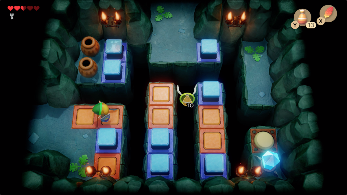 Link's Awaking Bottle Grotto gaps to jump, orange and blue tiles, a crystal, and a switch