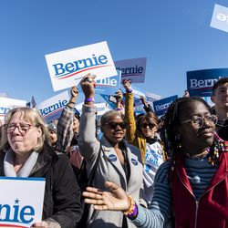 Sanders supporters cheer and wave their signs as a Bernie Sanders song plays ahead of a rally Saturday, March 7, 2020 in Grant Park.