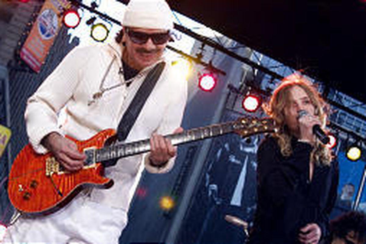 Guitarist Carlos Santana performs in New York's Times Square.