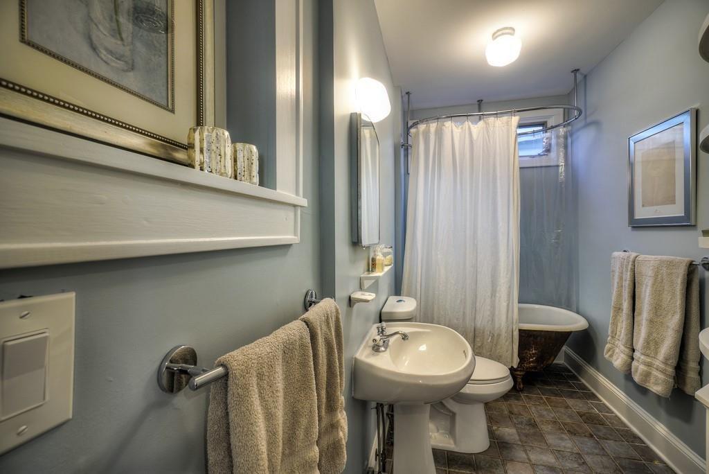 A blue bathroom with a clawfoot tub.