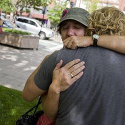 Sallie Shatz becomes emotional after photographing Tim DeChristopher leaving the federal courthouse in custody in Salt Lake City on Tuesday, July 26, 2011.