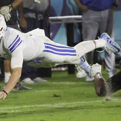 Brigham Young Cougars quarterback Zach Wilson (1) dives for additional yards after catching a pass against the UCF Knights during the Boca Raton Bowl in Boca Raton, Fla., on Tuesday, Dec. 22, 2020.