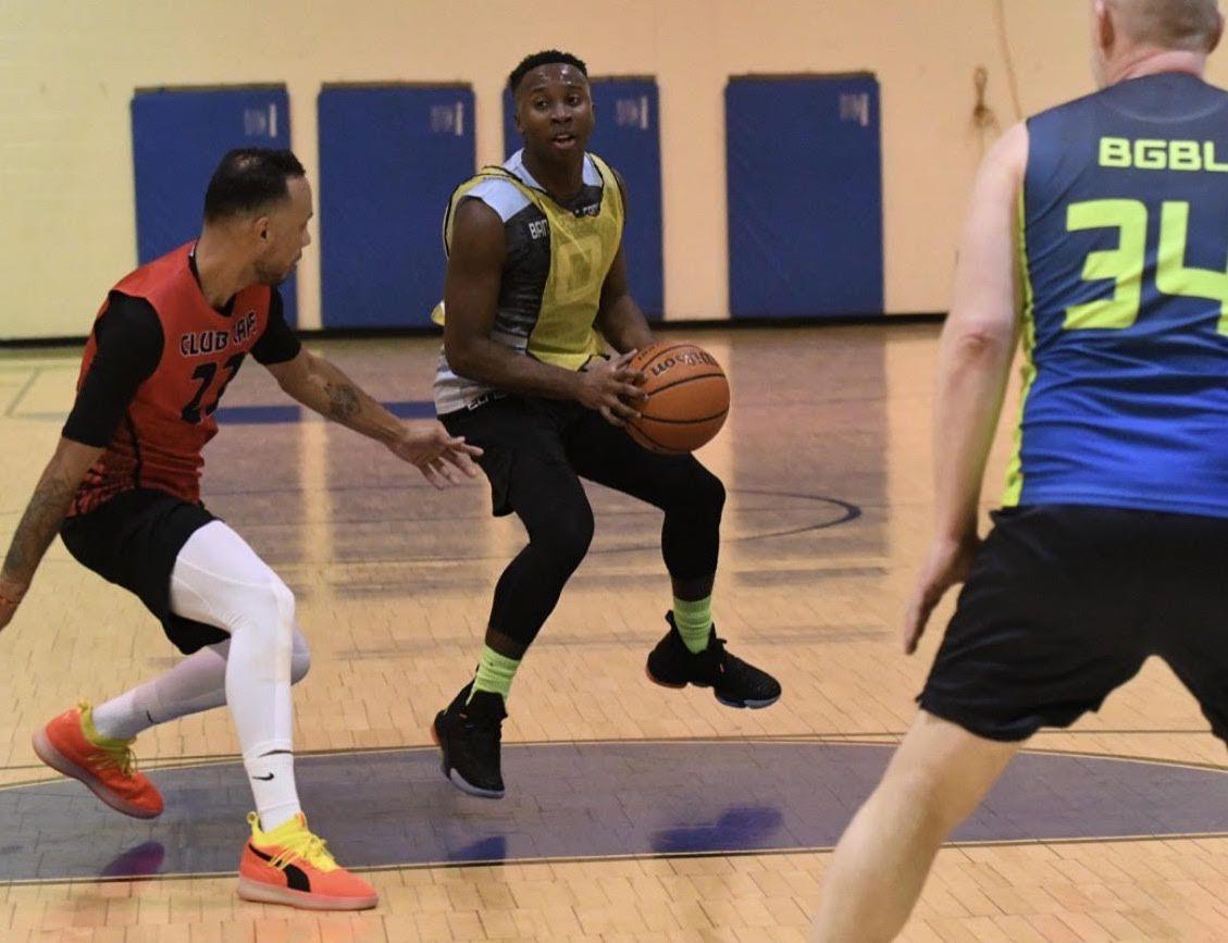 Quadry Allen handles the ball on a basketball court.