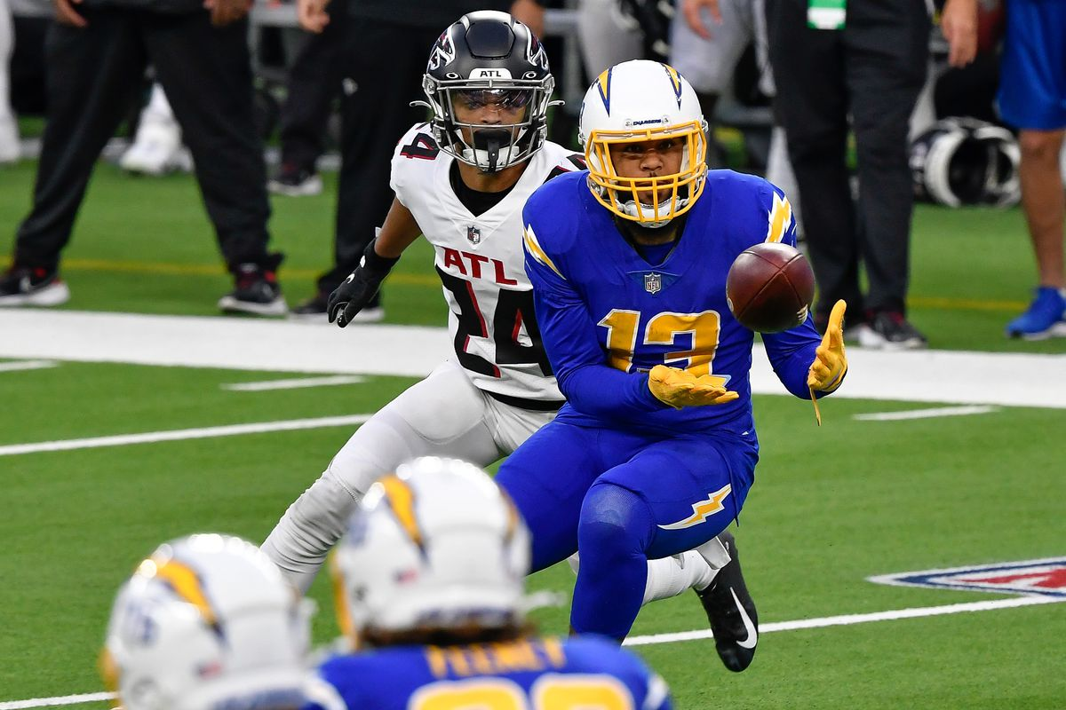 Los Angeles Chargers wide receiver Keenan Allen (13) catches a pass in front of Atlanta Falcons cornerback A.J. Terrell (24) in the fourth quarter at SoFi Stadium.