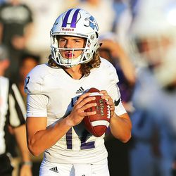 Lehi quarterback Cammon Cooper throws against Alta during their battle in Utah High School football action at Alta on Friday, Aug. 18, 2017.