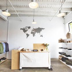"""World map behind the cash wrap. Apolis literally means """"global citizen."""""""