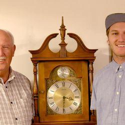 Boman Farrer (right) and his grandfather, Calvin Adams, are shown in Adams' home.