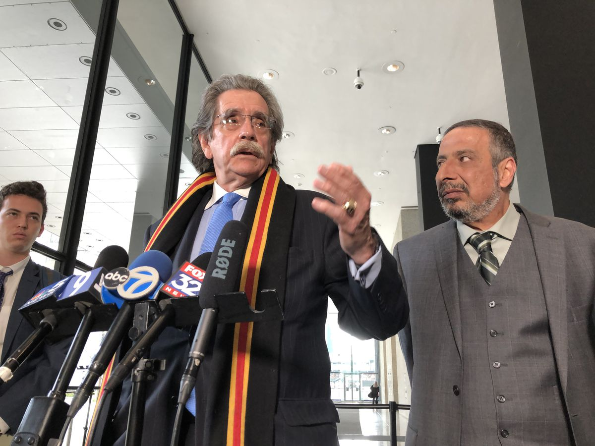 Attorney Thomas Anthony Durkin stands beside Ahmed Daoud on Monday in the lobby of the Dirksen Federal Building, where Daoud's son, Adel Daoud was sentenced to 16 years in federal prison for plotting to blow up a Chicago bar. | Andy Grimm / Sun-Times phot