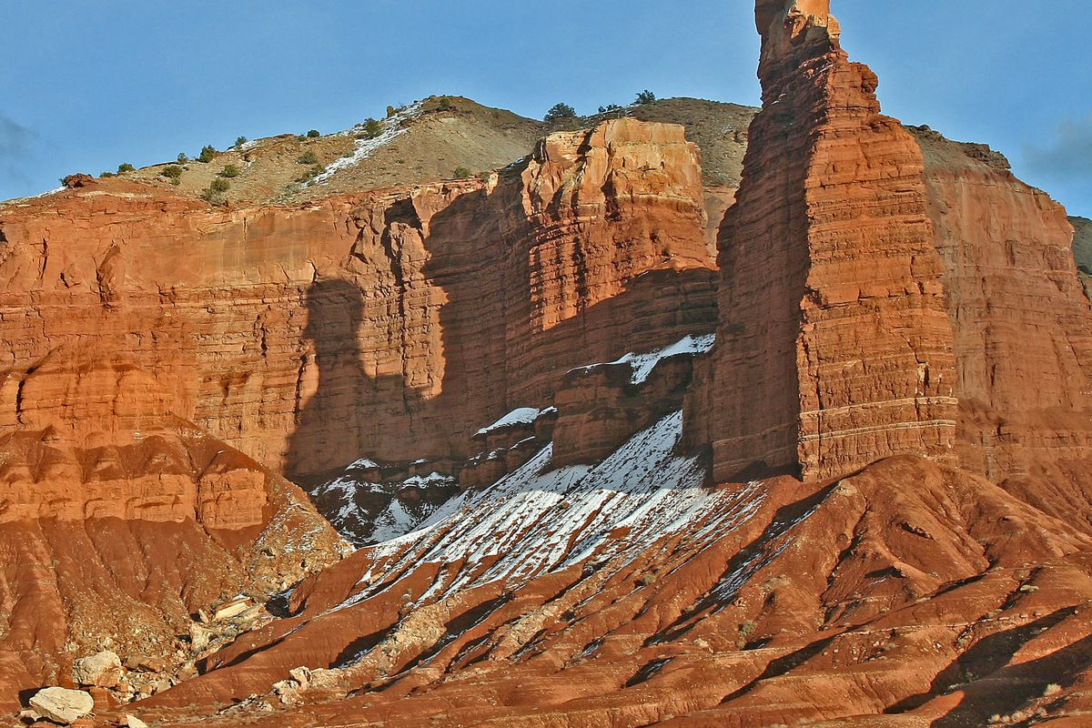 FILE - Late afternoon shadows make Chimney Rock appear even more dramatic at Capitol Reef National Park on Feb. 26, 2005. Visitors to the park in 2018 will see changes to the entrance fee and the group campsite, as well as to the management of the Fruita