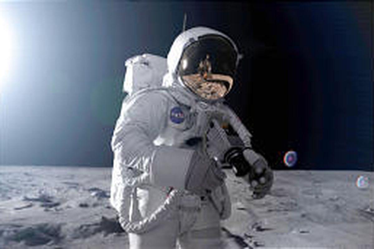 "Apollo 11 astronaut Neil Armstrong surveys lunar landscape in a re-creation for ""Magnificent Desolation."""