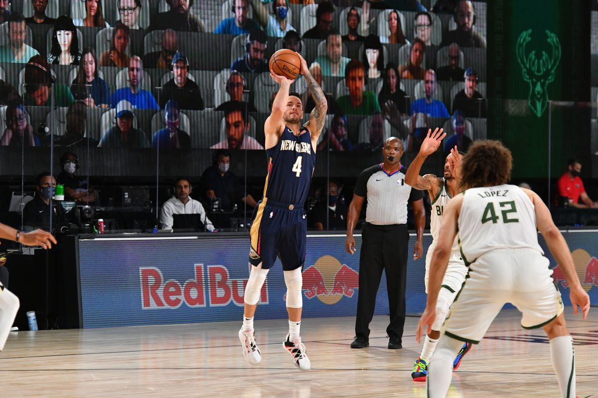 JJ Redick of the New Orleans Pelicans shoots a three point basket during the game against the Milwaukee Bucks during a scrimmage on July 27, 2020 at The Arena at ESPN Wide World of Sports in Orlando, Florida.