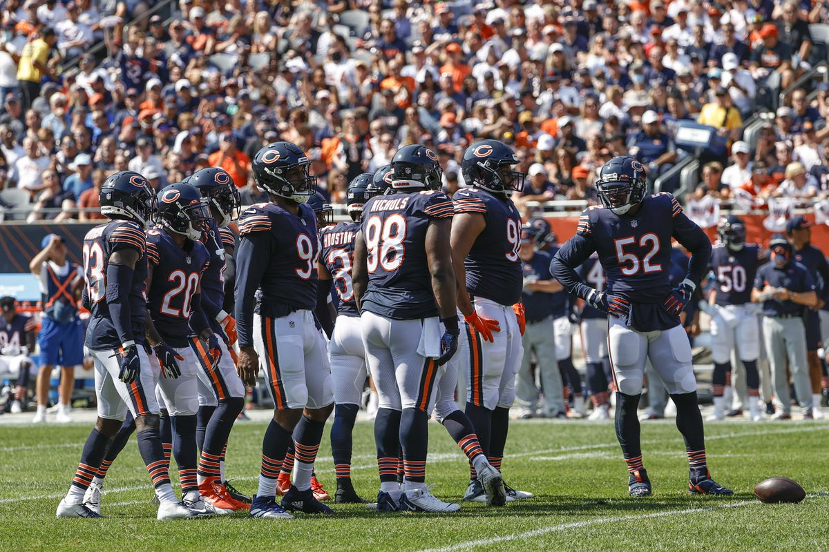 Bears defenders huddle during Sunday's win against the Bengals.