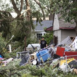 Residents survey the damage to several homes on Evergreen Lane near Janes Avenue in Woodridge after a tornado ripped through the western suburbs overnight, Monday morning, June 21, 2021.