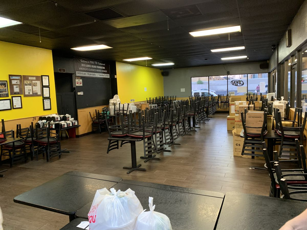 Closed dining room with only takeout food at Pho 79 in Garden Grove
