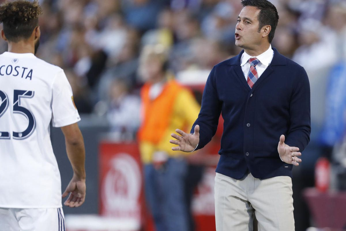 Real Salt Lake midfielder Danilo Acosta, left, is directed by head coach Mike Petke while facing the Colorado Rapids in the first half of an MLS soccer match, Saturday, April 15, 2017, in Commerce City, Colo.