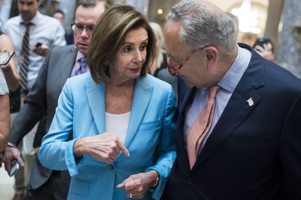 House speaker Nancy Pelosi and Senate minority leader Charles Schumer having a quiet word.