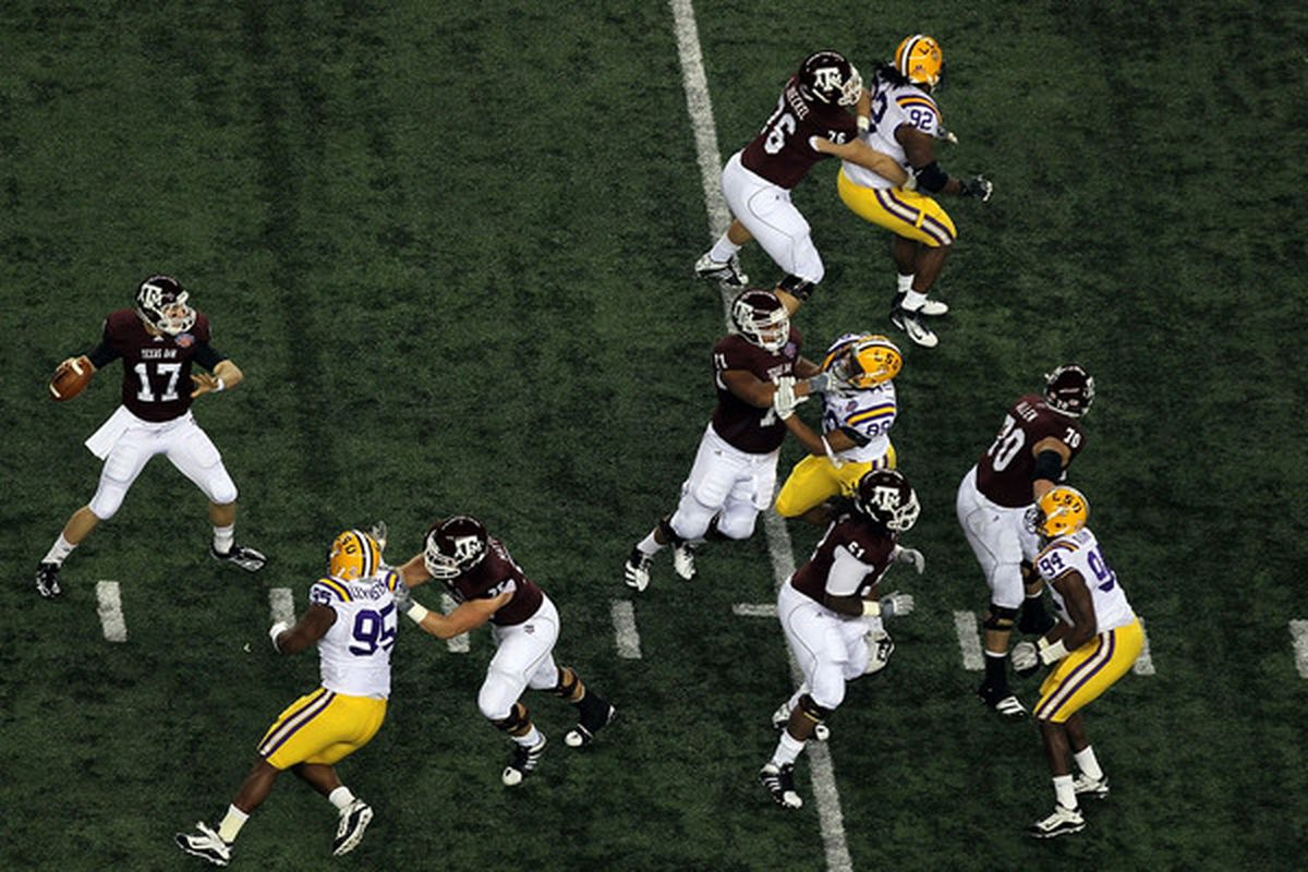 ARLINGTON TX - JANUARY 07:  Quarterback Ryan Tannehill #17 of the Texas A&M Aggies throws against the LSU Tigers during the AT&T Cotton Bowl at Cowboys Stadium on January 7 2011 in Arlington Texas.  (Photo by Ronald Martinez/Getty Images)