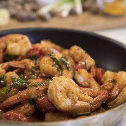 Sautee shrimp with tomatoes,tomato paste, curry, cumin, salt and pepper   Ashlee Rezin/Sun-Times