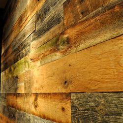 Reclaimed wood from barns in the Northeast line the walls.