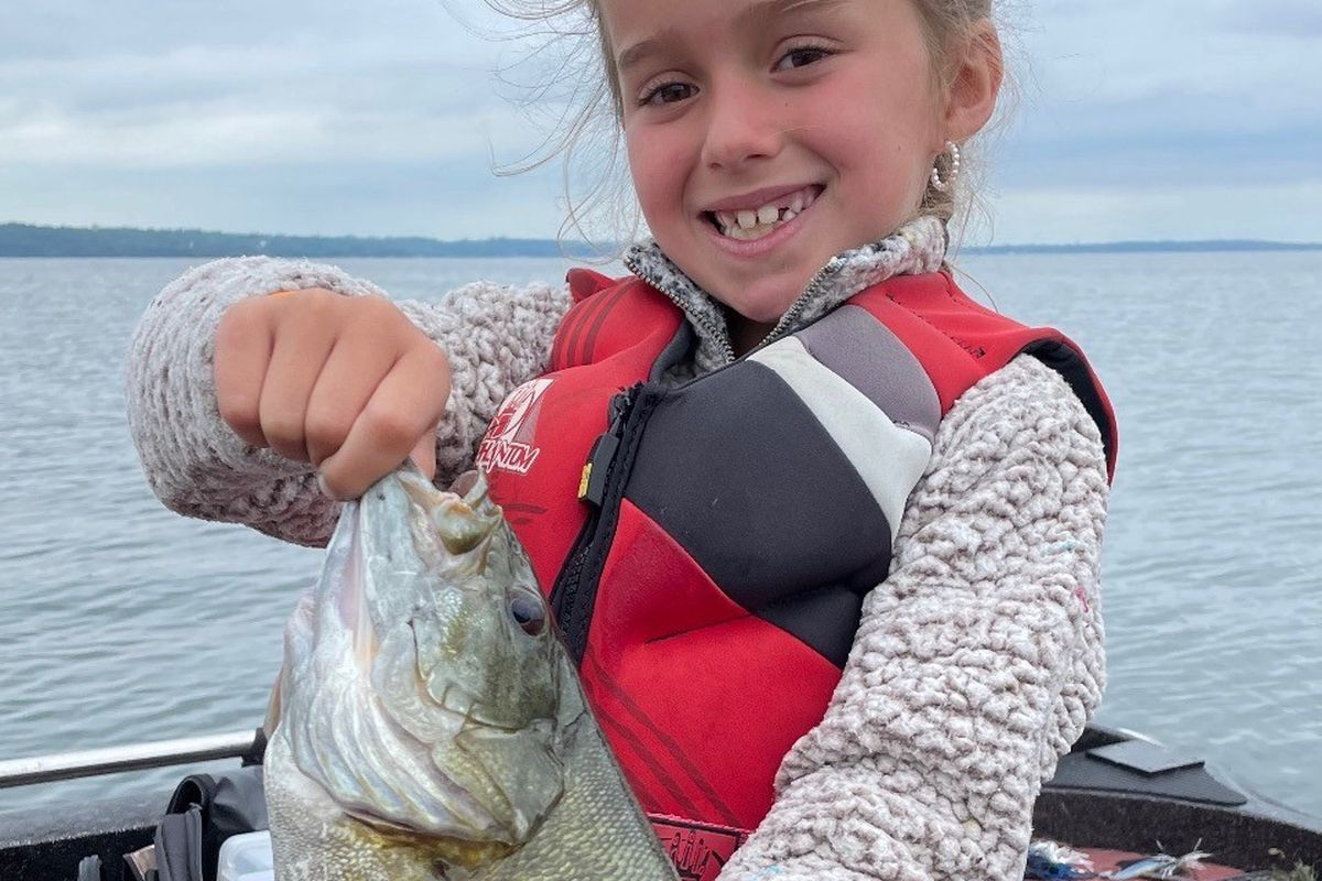 Leighton Cooper enjoyed a good smallmouth on Big Green Lake last week with her father and guide Mike Norris. Provided