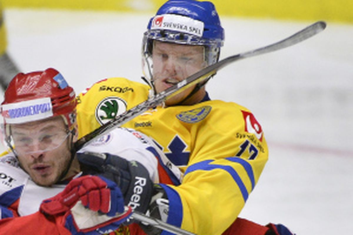 """Carl Soderberg wearing a Team Sweden sweater.  """"What are things I don't expect to see, Alex?"""""""