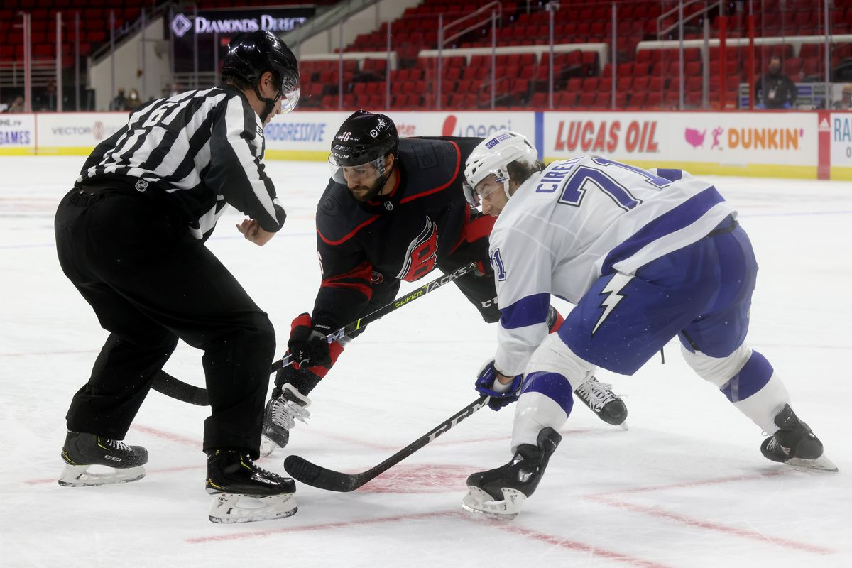 Vincent Trocheck #16 of the Carolina Hurricanes prepares for a face-off against Anthony Cirelli #71 of the Tampa Bay Lightning on January 28, 2021 at PNC Arena in Raleigh, North Carolina.