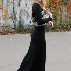 """Emily Schuman of <a href=""""http://cupcakesandcashmere.com/back-to-black-2/"""" rel=""""nofollow"""">Cupcakes and Cashmere</a> is wearing a Forever 21 hat, a Topshop dress, vintage belt and bracelets, a Coach clutch, and Steve Madden booties."""