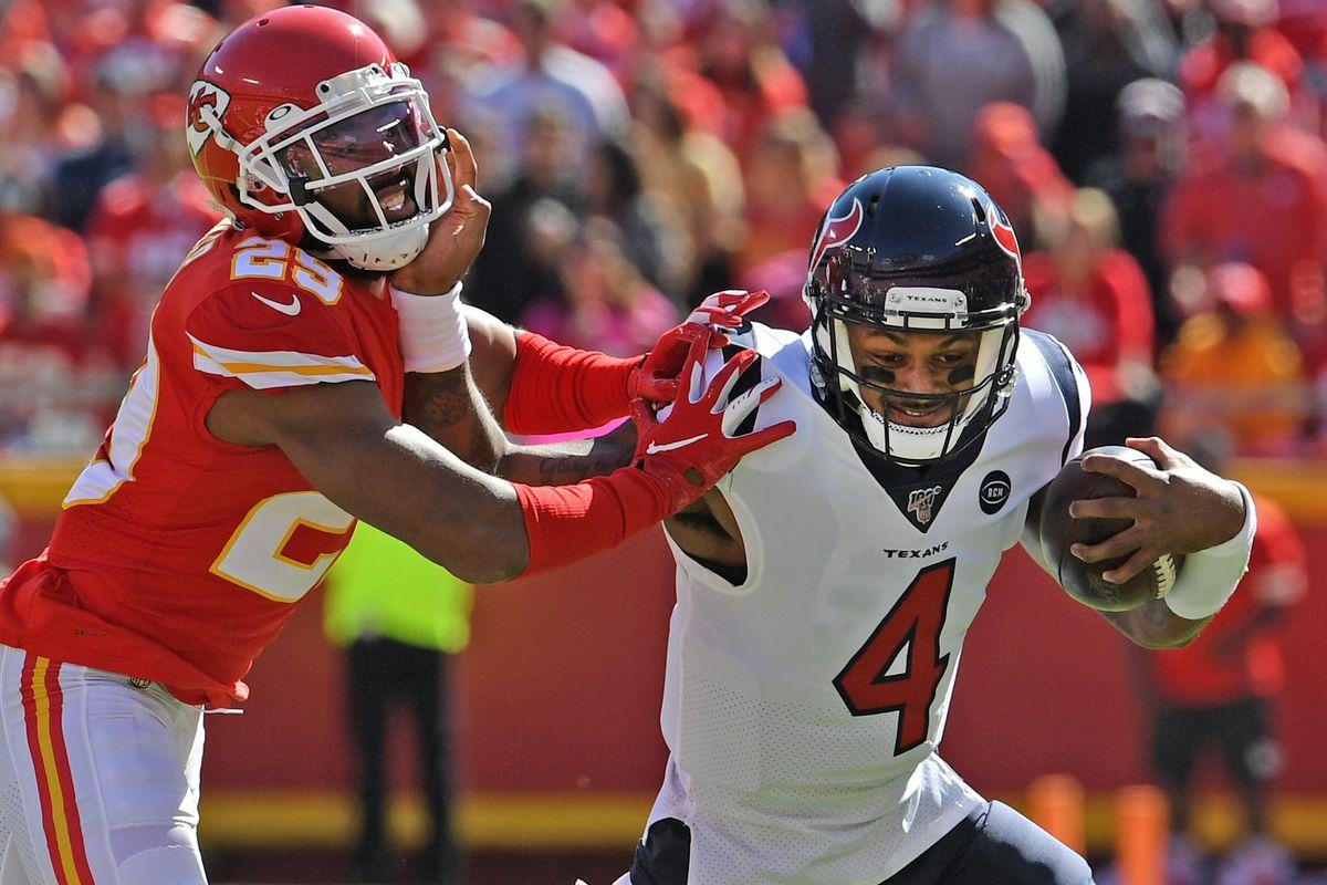 Quarterback Deshaun Watson #4 of the Houston Texans rushes against cornerback Kendall Fuller #29 of the Kansas City Chiefs during the first quarter at Arrowhead Stadium on October 13, 2019 in Kansas City, Missouri.
