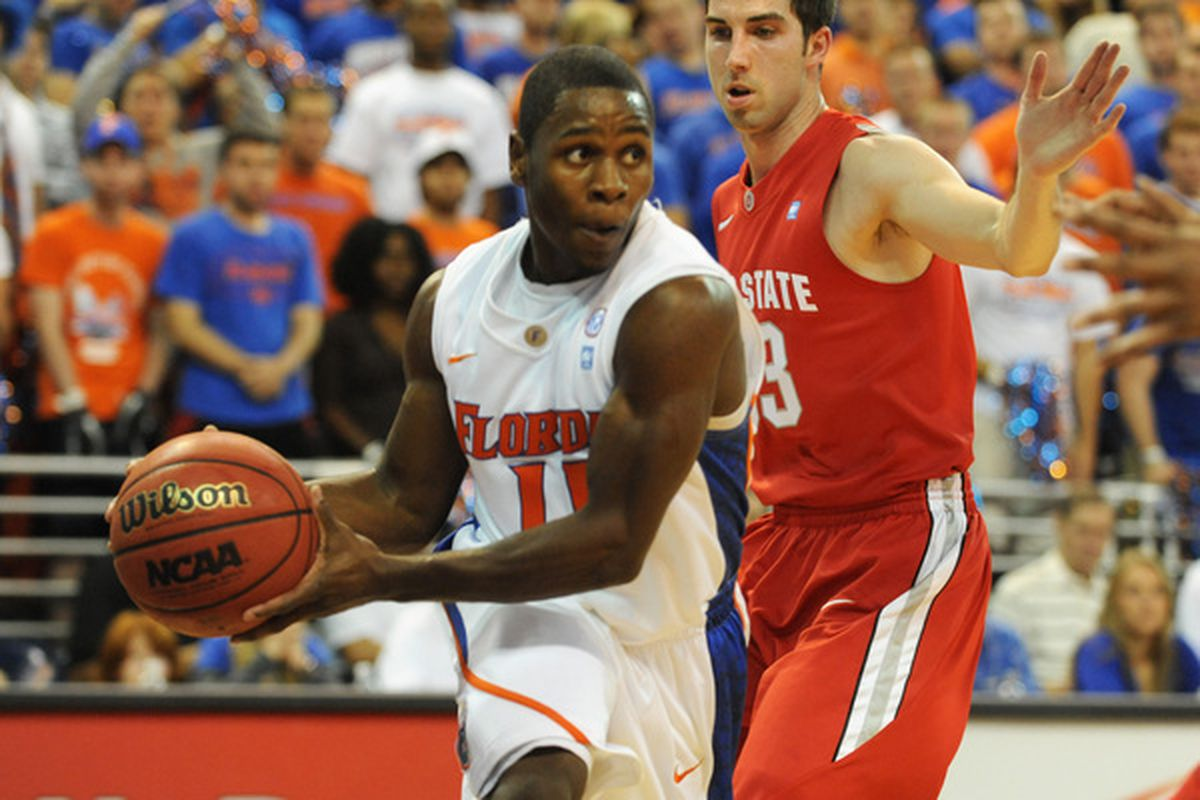 GAINESVILLE FL - NOVEMBER 16: Guard Erving Walker #11 of the Florida Gators looks to pass against the Ohio State Buckeyes November 16 2010 at the Stephen C. O'Connell Center in Gainesville Florida.  (Photo by Al Messerschmidt/Getty Images)