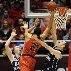 Utah Utes forward Jordan Loveridge (21) splits the BYU defense to the basket during a game at the Jon M. Huntsman Center on Saturday, December 14, 2013.