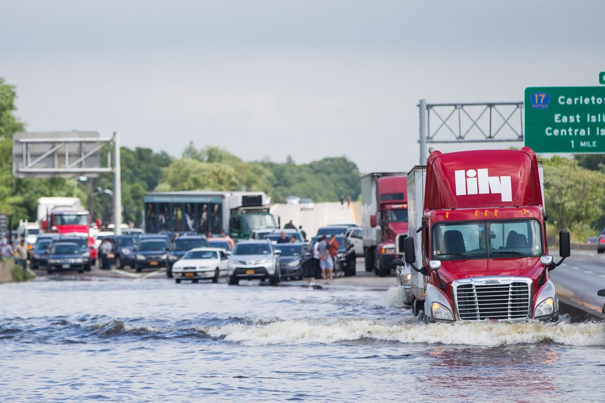 A trailer truck drives through flooded Sunrise Highway at Route 111 following heavy rains and flash flooding August 13, 2014, in Islip, New York.