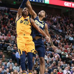 Utah Jazz forward Thabo Sefolosha (22) dunks on Denver Nuggets forward Trey Lyles (7) at Vivint Smart Home Arena in Salt Lake City on Tuesday, Nov. 28, 2017.