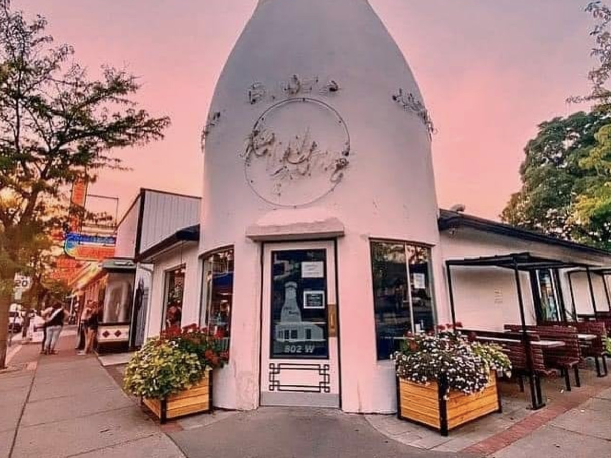 The outside of the milk bottle-shaped Mary Lou's Milk Bottle in Spokane with a pinkish-blue sky in the background