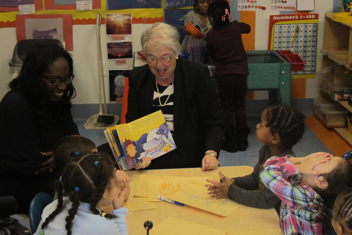 New York City schools Chancellor Carmen Fariña reads to children at Sunshine Learning Center in the Bronx in 2015.